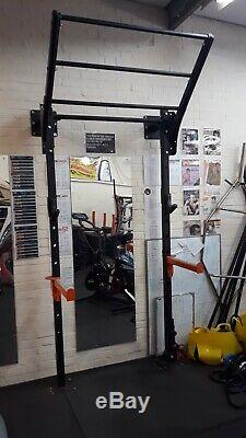 WALL MOUNTED SQUAT RACK (space saving) with extras. Tiered pull up bar etc
