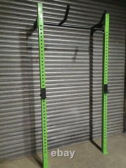 Wall mounted squat rack + FREE plastic lined j-pegs